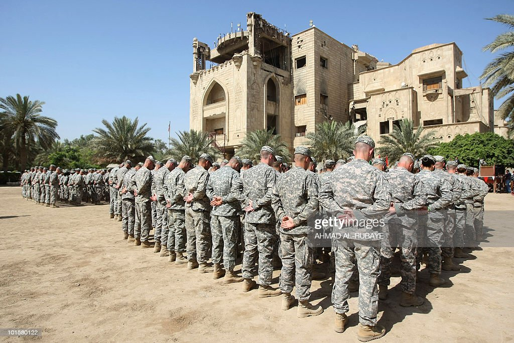 US soldiers stand at attention during a handover ceremony of the 'entry control points' of Baghdad's Green Zone, now referred to as the International Zone, to Iraqi control inside the heavily-fortified compound in Baghdad on June 1, 2010.