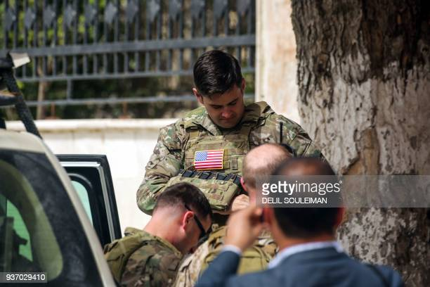 US Soldiers stand at attention during a visit of a US delegation to the YPGheld northern Syrian city of Manbij where the US has a military presence...