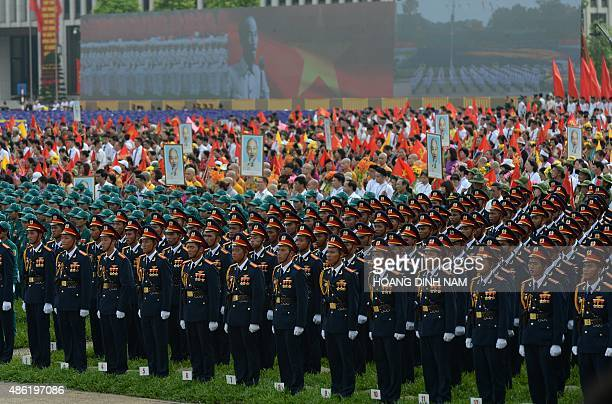 Soldiers stand at attention prior to a parade in front of the mausoleum of late president Ho Chi Minh founder of today's communist Vietnam as the...