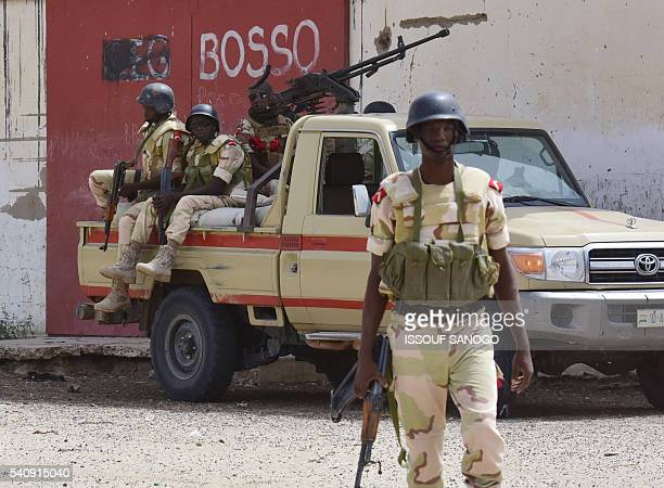 Soldiers stand at Bosso military camp on June 17 2016 following attacks by Boko Haram fighters in the region Boko Haram on June 9 attacked a military...