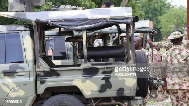 Soldiers stand beside truck to close offices of humanitarian group Action Against Hunger in the restive Maiduguri northeast Nigeria on September 19...