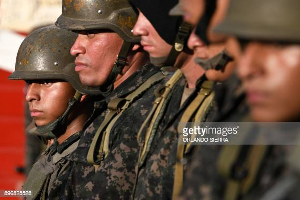 Soldiers stand by as supporters of the presidential candidate for the Opposition Alliance Against the Dictatorship Salvador Nasralla protest against...