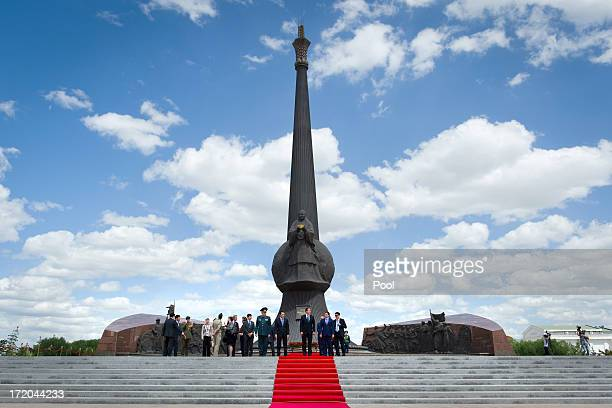 Soldiers stand guard ahead of a wreathlaying ceremony by British Prime Minister David Cameron at the Monument of the Motherland Defenders on July 1...