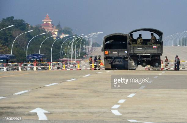 Soldiers stand guard along a blockaded road near Myanmar's Parliament in Naypyidaw on February 2 as Myanmar's generals appeared in firm control a day...