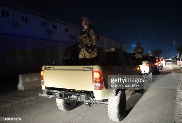 US Soldiers stand guard as US President Donald Trump makes a surprise Thanksgiving day visit to the US troops at Bagram Air Field on November 28 2019...