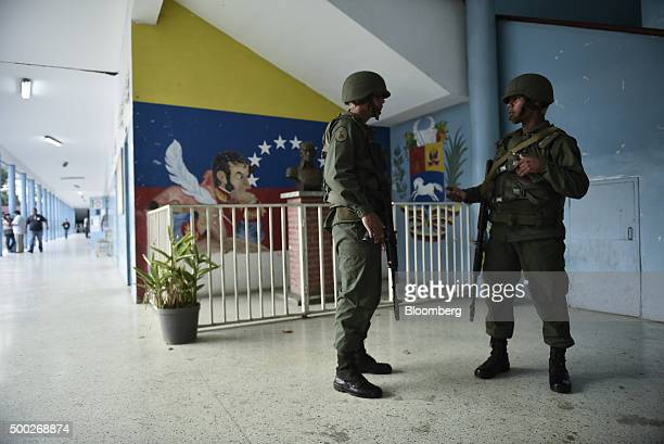 Soldiers stand guard at a polling station in the Coche area during the national congressional elections in Caracas Venezuela on Sunday Dec 6 2015...