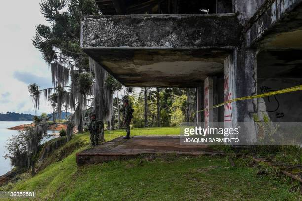 Soldiers stand guard at La Manuela a former vacation estate of late drug kingpin Pablo Escobar's family on El Penol reservoir in the municipality of...