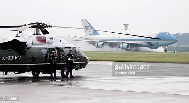 Soldiers stand guard at Marine One as Air Force One, carrying US President George W. Bush, lands at the airport on June 5, 2007 in Rostock-Laage,...