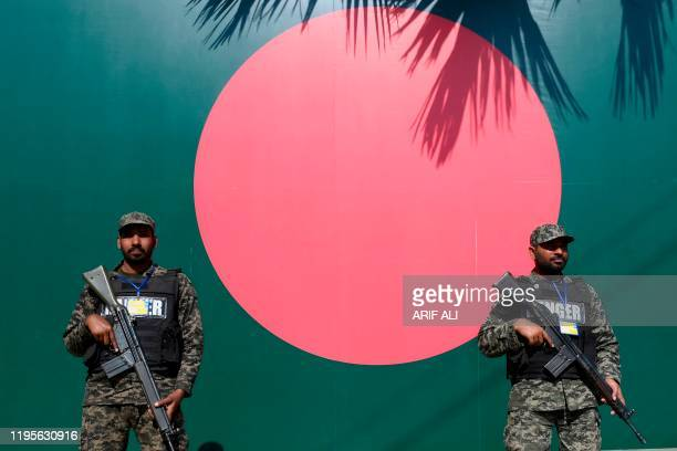 Soldiers stand guard beside Bangladesh's national flag outside the Gaddafi Cricket Stadium in Lahore on January 24 before the start of the first T20...