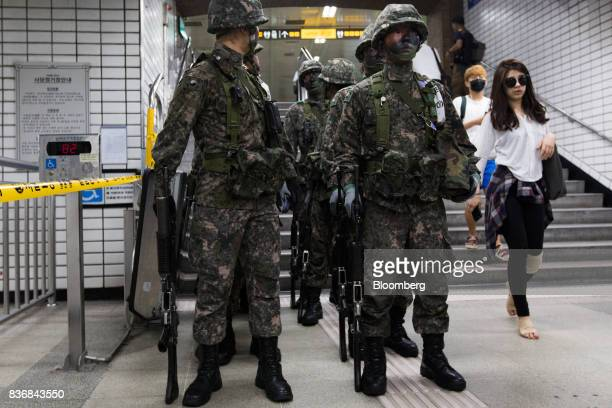 Soldiers stand guard during an antiterror drill on the sidelines of the Ulchi Freedom Guardian military exercises at a subway station in Seoul South...