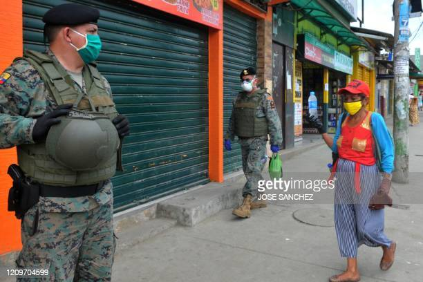Soldiers stand guard in a street of Guayaquil Ecuador on April 11 2020 Guayaquil Mayor Cynthia Viteri suggested Friday using lines of soldiers to...