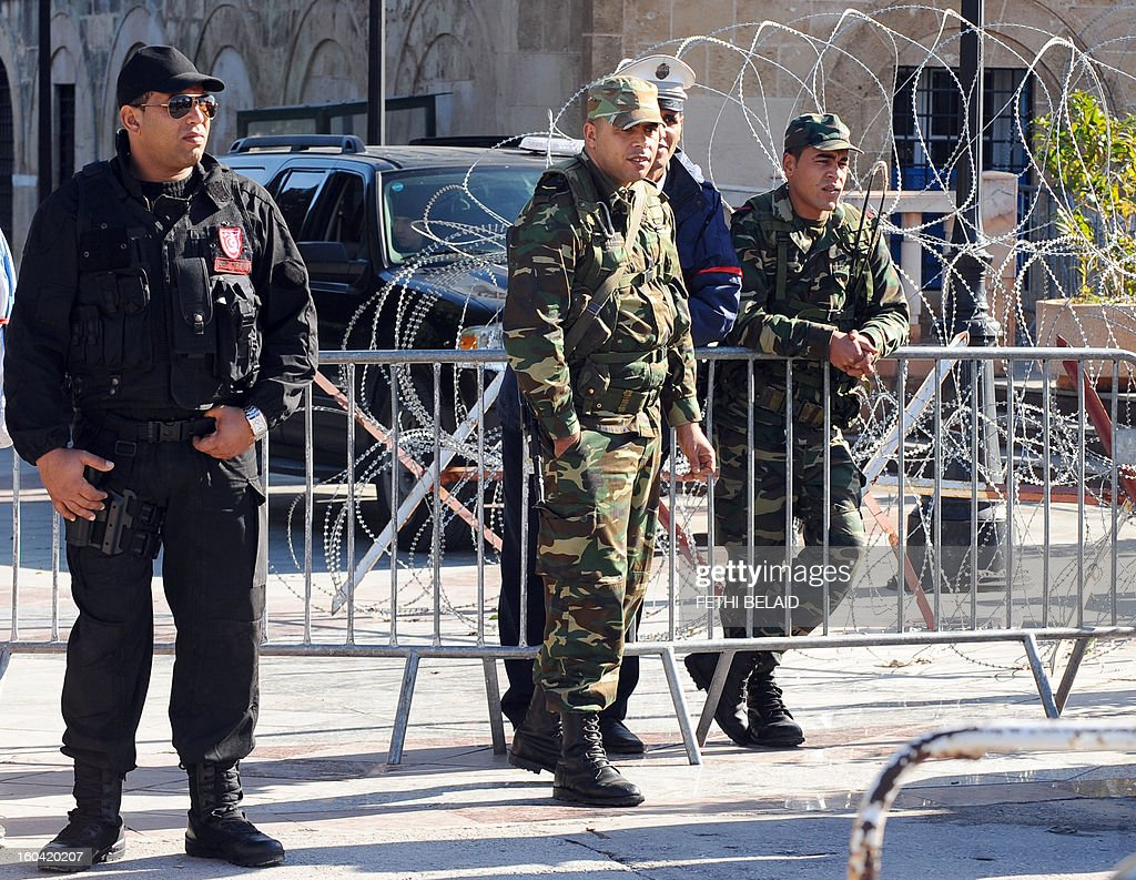 Soldiers stand guard in front of the Prime Minister office in la Kasbah as security measures are reinforced as part of the ongoing state of emergency which has been declared since the fall of ex-president on January 31, 2013 in Tunis. Tunisian President Moncef Marzouki should decide today wether to continue the state of emergency or not.