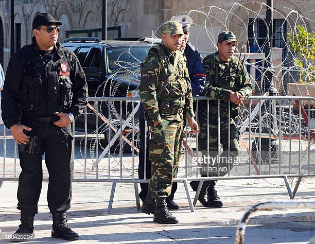 Soldiers stand guard in front of the Prime Minister office in la Kasbah as security measures are reinforced as part of the ongoing state of emergency...