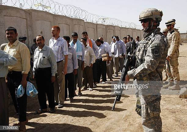 S soldiers stand guard in the prison compound shortly before another batch of 200 prisoners are freed from Abu Ghraib prison on June 15 2006 in...