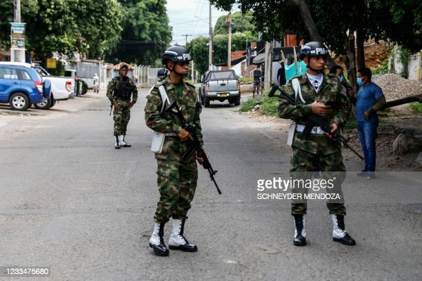 Soldiers stand guard near a military unit in Cucuta, Colombia, on the border with Venezuela,on June 15, 2021. - A vehicle exploded Tuesday at a...