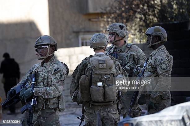 US soldiers stand guard near an Iraqi army base on the outskirts of Mosul on November 23 2016 Forces battling the Islamic State group in northern...