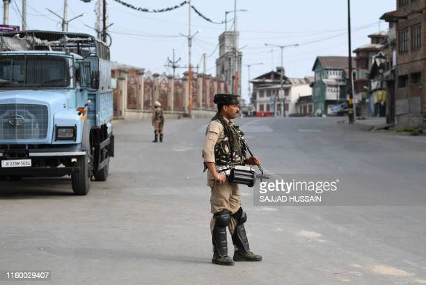 Soldiers stand guard on a street during a curfew in Srinagar on August 6 2019 India's home affairs minister on August 6 hailed historic legislation...