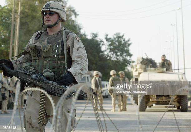 US soldiers stand guard outside the children's hospital in Baqubah northeast of Baghdad where three US soldiers guarding the facility were killed and...