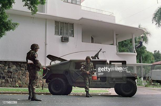 US soldiers stand guard outside the Vatican embassy in Panama City where Panamanian General Manuel Noriega is seeking asylum during Operation Just...
