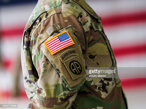 US soldiers stand in formation during a military ceremony at the Storck barracks in Illesheim Germany 9 March 2017 The 12th helicopter brigade of the...