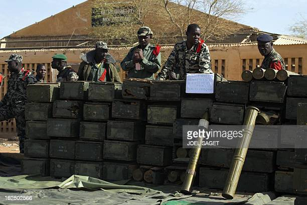 Soldiers stand in front of ammunitions seized from Islamist fighters exhibited by the Malian army in the centre of Gao on February 24, 2013. Tuareg...