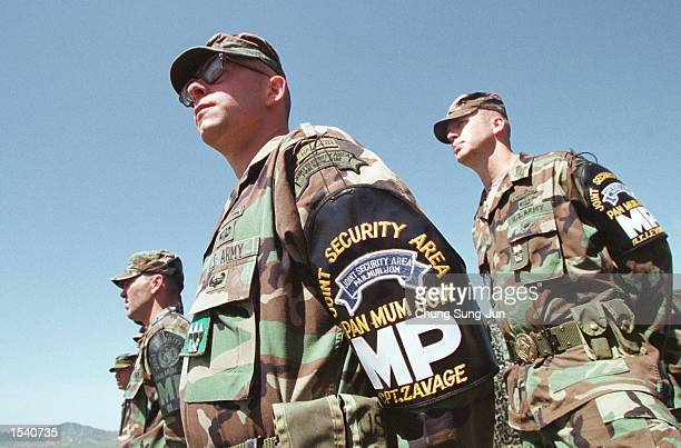 S soldiers stand May 8 2002 at an outpost in the Demilitarized Zone in South Korea A group of US Korean War veterans and relatives of those who have...