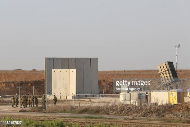 Soldiers stand near a battery of Iron Dome defence missile system, designed to intercept and destroy incoming short-range rockets and artillery...