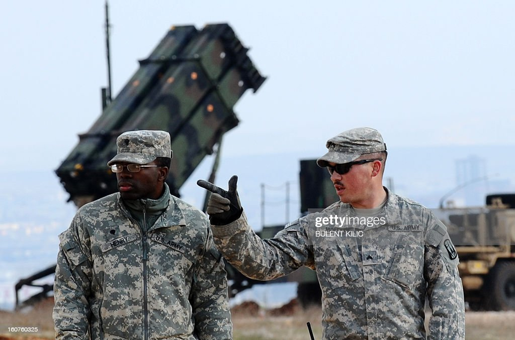US soldiers stand near a Patriot missile system at a Turkish military base in Gaziantep on February 5, 2013. The United States, Germany and the Netherlands committed to send two missile batteries each and up to 400 soldiers to operate them after Ankara asked for help to bolster its air defences against possible missile attack from Syria.
