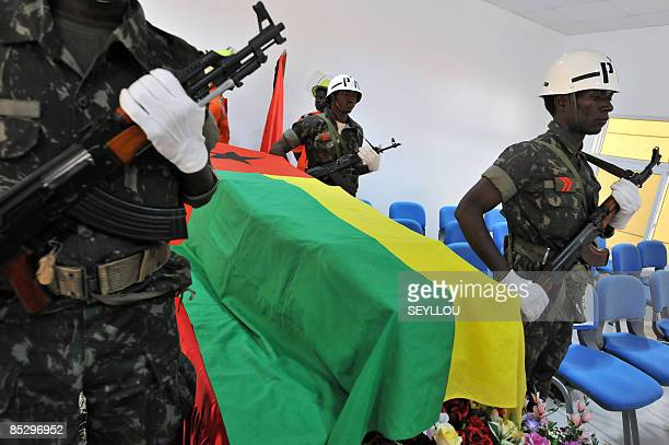 Soldiers stand on March 8 209 next to the coffin of GuineaBissau army chief General Batista Tagme Na Waie in Bissau during a state funeral a week...