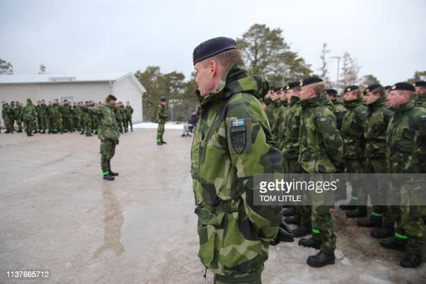 Soldiers stand on parade at a base near the town of Visby on February 5 as part of a ceremony commemoration the foundation of the Gotland Regiment...