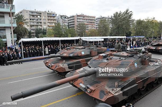 Soldiers stand on tanks as they take part in a military parade in Thessaloniki on October 28 during the celebrations marking Greece's National 'Oxi '...