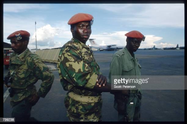 Soldiers stand on the tarmac April 7 1994 in Kigali Rwanda Following the apparent assassination of Rwandan President Juvenal Habyarimana the Hutu...