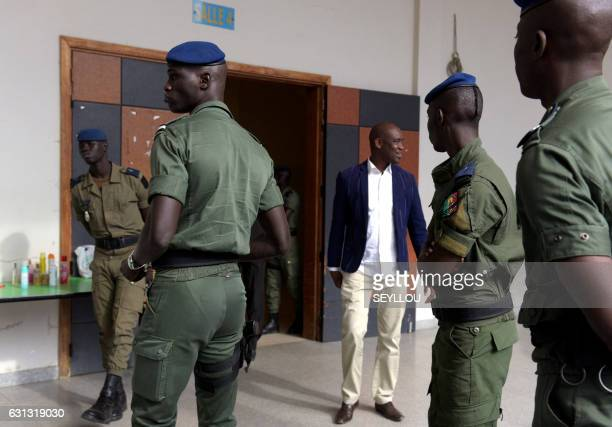 Soldiers stand outside a courtroom at Dakar courthouse on January 9 2017 on the first day of the former Chadian dictator Hissene Habre appeal trial...