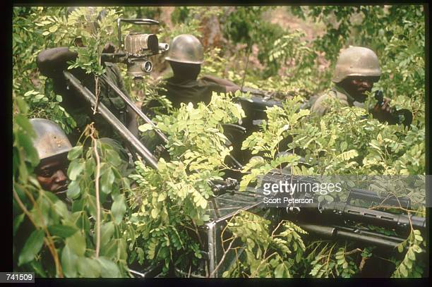 Soldiers stand with anti-tank weapons January 23, 1990 near Jamba, Angola. The National Union for the Total Independence of Angola and the Marxist...