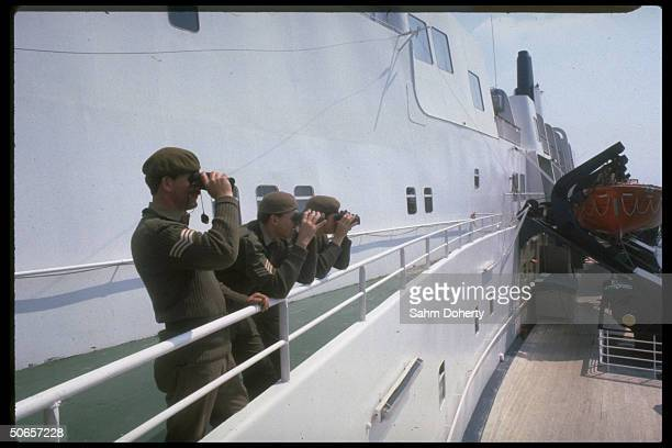 Soldiers standingon deck of QE2 before sailing for Falklands