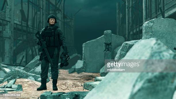 soldiers stands in the rubble in a warzone holding a weapon - task force stock pictures, royalty-free photos & images