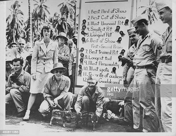 Soldiers stationed in Guadalcanal during World War Two, with American Red Cross volunteer Mrs Patricia O'Neill, Solomon Islands, circa 1940-1945.