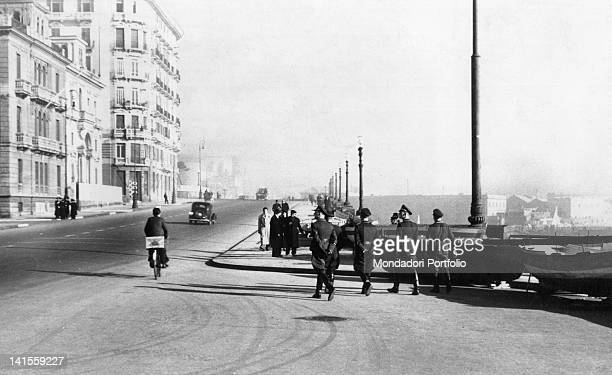 SS soldiers strolling along the waterfront near the harbour Naples February 1941