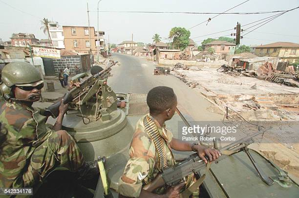 ECOMOG soldiers supervise the town