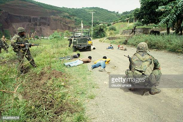 US soldiers survey prisoners during the US invasion of Grenada | Location Grenada