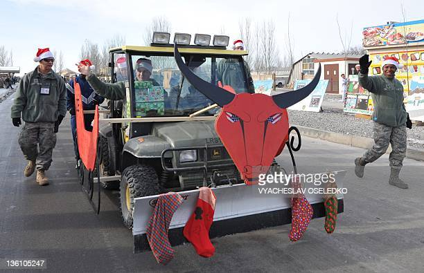 US soldiers take part in a Christmas parade at the US Transit Center of Manas' airport in the outskirts of Bishkek on December 25 2011 The United...