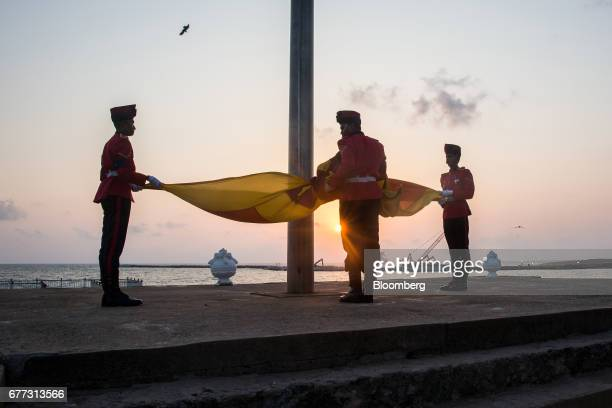 Soldiers take part in a flag lowering ceremony at Galle Face Green in Colombo Sri Lanka on Saturday April 22 2017 Once fought over by European powers...