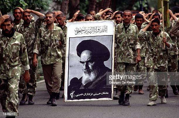 Soldiers take part in a funeral procession June 6, 1989 for the Ayatollah Ruhollah Khomeini in Tehran, Iran. Millions of mourners attended the Muslim...