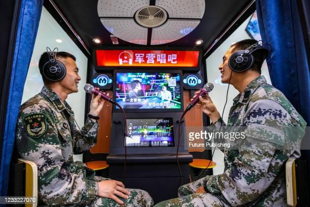 Soldiers take part in a karaoke song at a military barracks in Zhenjiang, east China's Jiangsu Province, June 1, 2021.