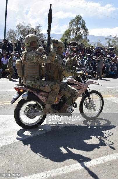 Soldiers take part in a parade for the commemoration of the 193rd anniversary of the creation of the Bolivian Armed Forces in Cochabamba, Bolivia on...