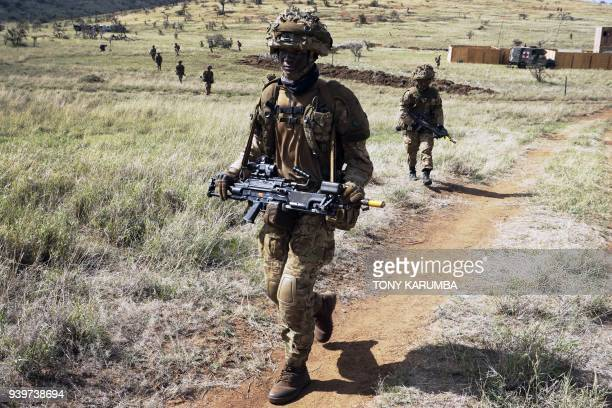 Soldiers take part in a simulated military excercise of the British Army Training Unit in Kenya together with the Kenya Defence Forces at the olDaiga...