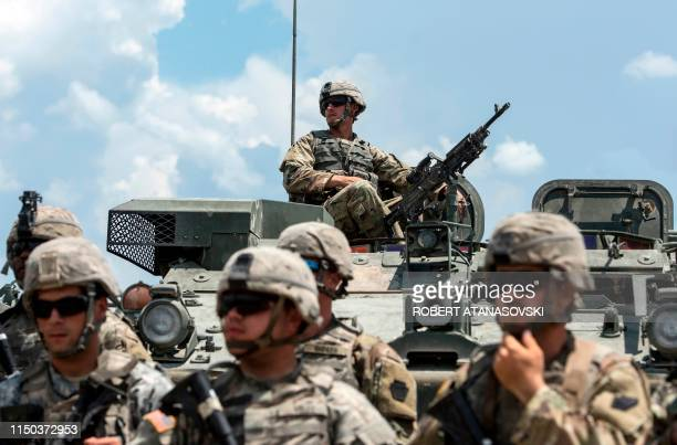 US soldiers take part in the 'Decisive Strike' military exercise in their camp at the Training Support Centre Krivolak near Skopje on June 17 2019...