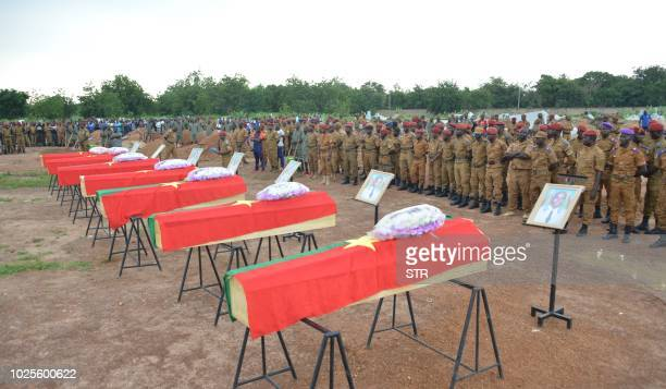 Soldiers take part in the funeral ceremony of the seven members of the security forces killed three days ago after their vehicle struck a roadside...