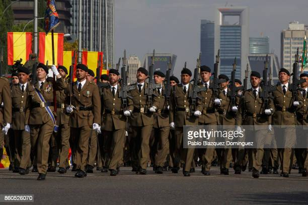 Soldiers take part in the Spain's National Day military parade at Castellana Street on October 12 2017 in Madrid Spain Madrid celebrates every...