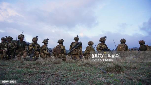 Soldiers take position during a simulated military excercise of the British Army Training Unit in Kenya together with the Kenya Defence Forces at the...